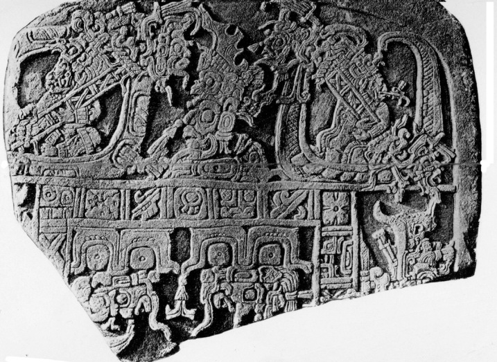 Figure 3. The top fragment of Stela 4 from Yaxchilan (front), showing the parents of Bird Jaguar IV as the sun and the moon. Took'al Ajaw, with his flint headdress, appears between them as another  celestial deity. (Photograph by Teobert Maler)